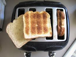 Put 2 slices of bread in one toaster slot