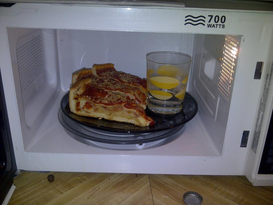 Microwave Leftover Pizza with water