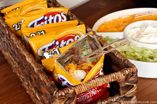 Throw taco toppings in a bag of Fritos for taco salad